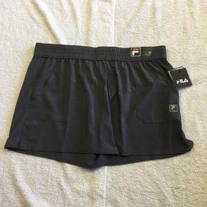 41cdb30c5de7 Fila Shorts - WOMEN S FILA SPORT EXTENDED WOVEN WORKOUT SHORTS